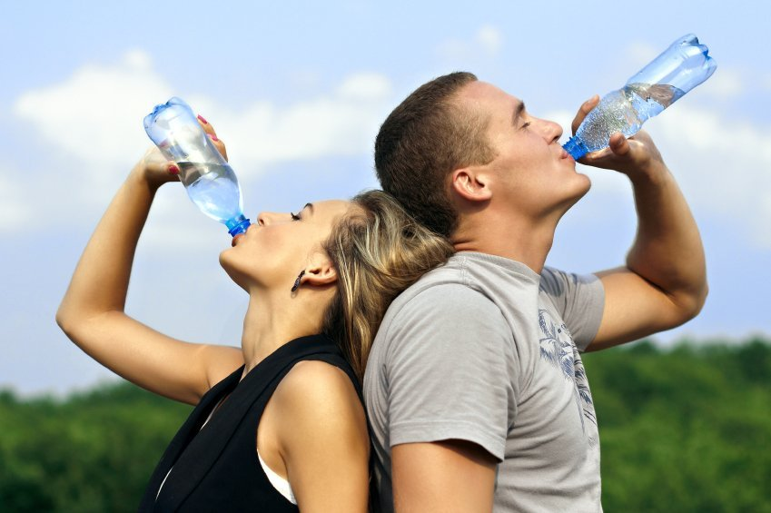 young couple drinking water